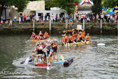 "Kingsbridge - Kingsbridge Fair Week - Raft Race - ""Rafty McRaftface"" head off The ""Faux Fur Vikings"" and ""HMS Quayside"" at the turn"