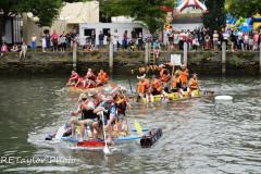 "Kingsbridge - Kingsbridge Fair Week - Raft Race - ""Rafty McRaftface"" head off The ""Faux Fur Vikings"" and ""HMS Quayside"" at the turn"